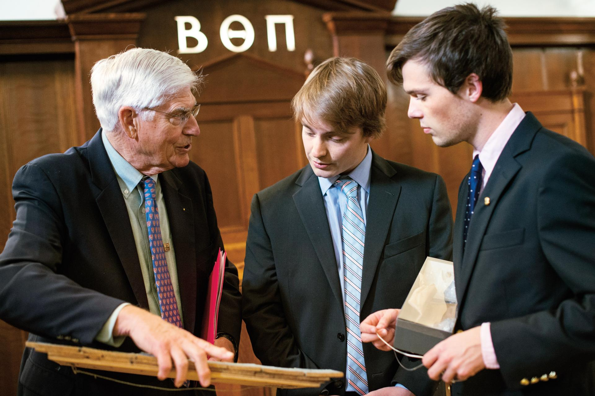 Allen Splete '60 shows current Beta Zeta brothers shingles from the original chapter house.