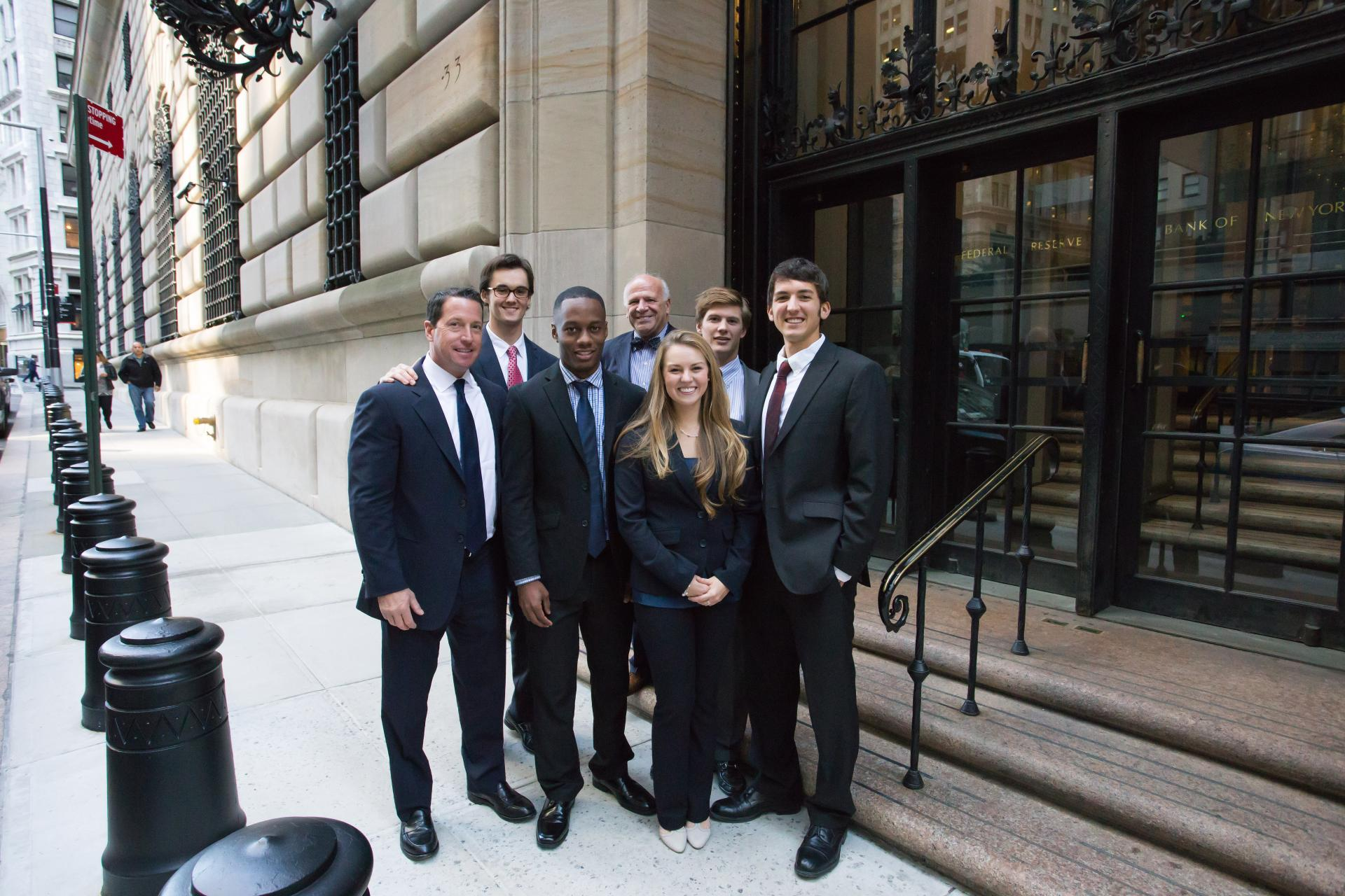 In front of the Federal Reserve Bank of New York, St Lawrence's College Fed Challenge team poses with Tom Sapio '88, a partner at Cantor Fitzgerald (left), and the bank's chief economist, Harvey Goldsmith (bowtie).