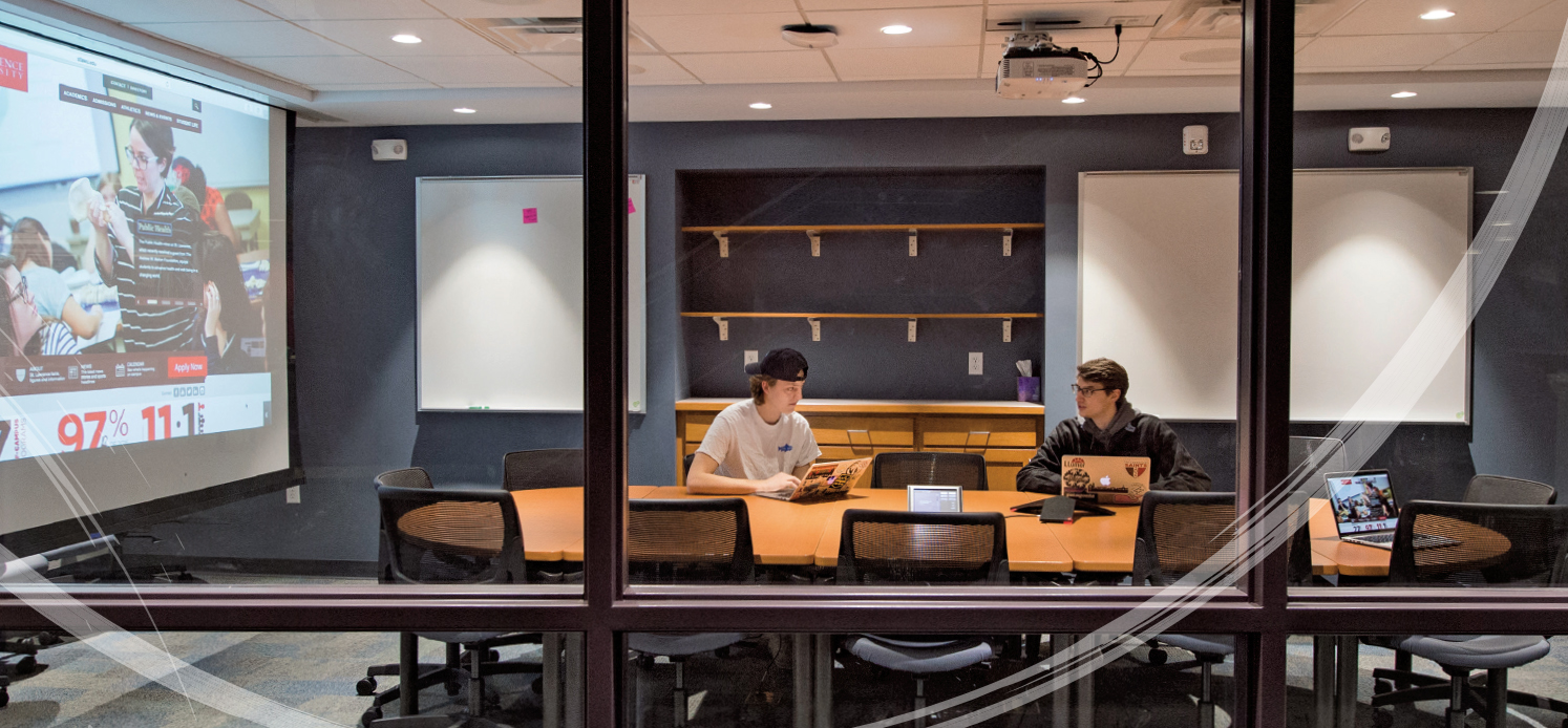 Students taking advantage of one of the new conference spaces available for students, faculty and staff.