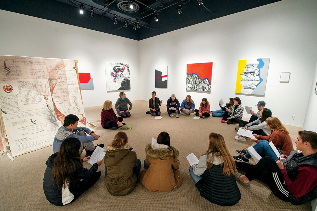 Students from the Peace Begins with Me class take in the exhibition