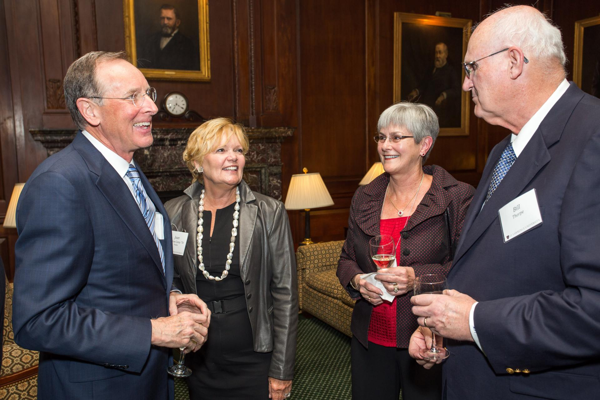 President Fox and University Trustee Joan Darrow Corey '74 (left) chat with Judy Frear Thorpe '69 and her husband, Bill.