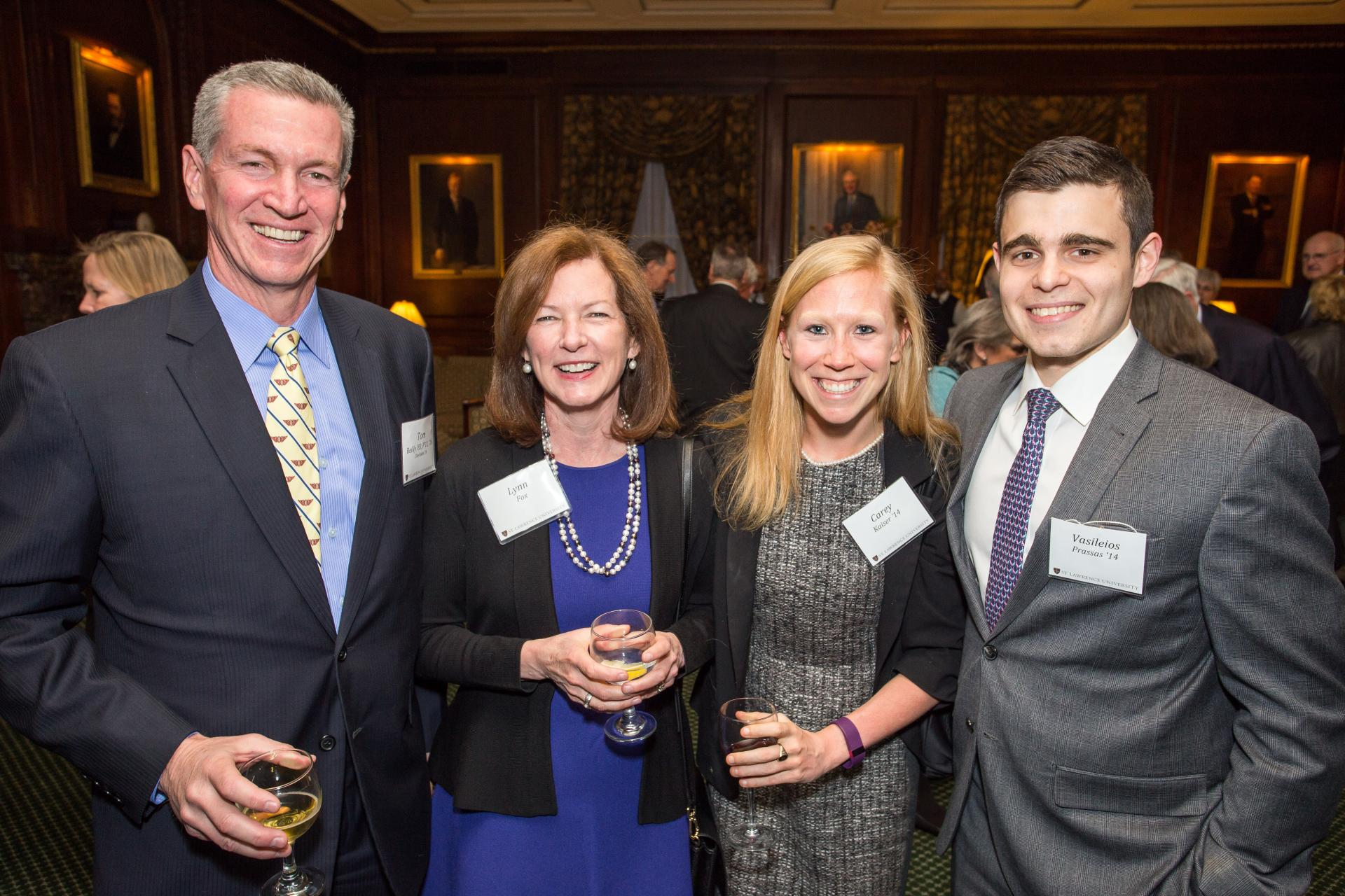 Left to Right: Tom Reilly '83, P'11, '16, Lynn Fox, Carey Kaiser '14, Vasileos Prassas '14. Fox, Kaiser and Prassas spoke about experiential learning and the alumni network in New York City.