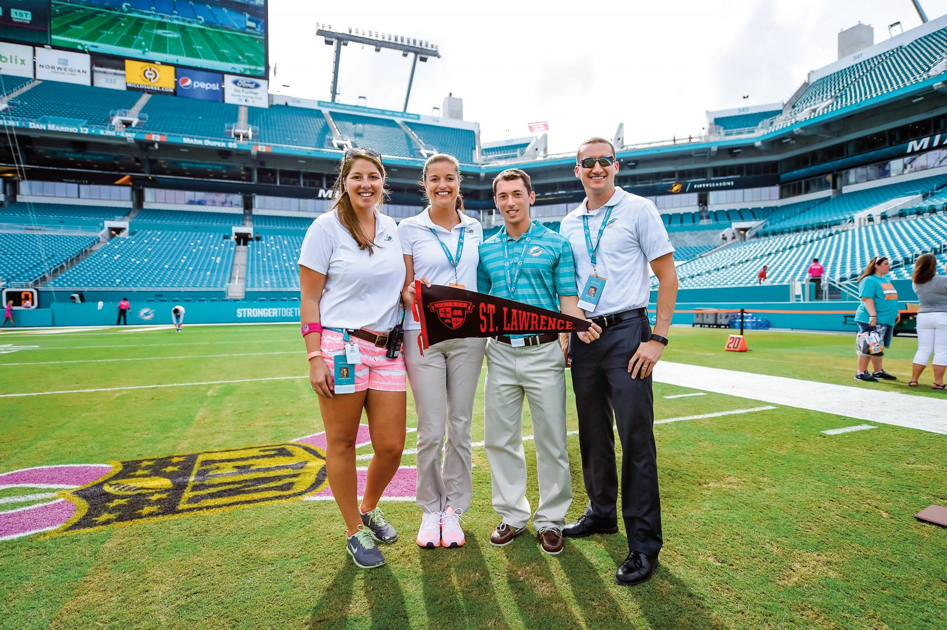 From left, Amanda Chase �12, Casey Capello �12, Tom Pasquali �12 and Dennis Lock �08 at the Miami Dolphins� Sun Life Stadium.