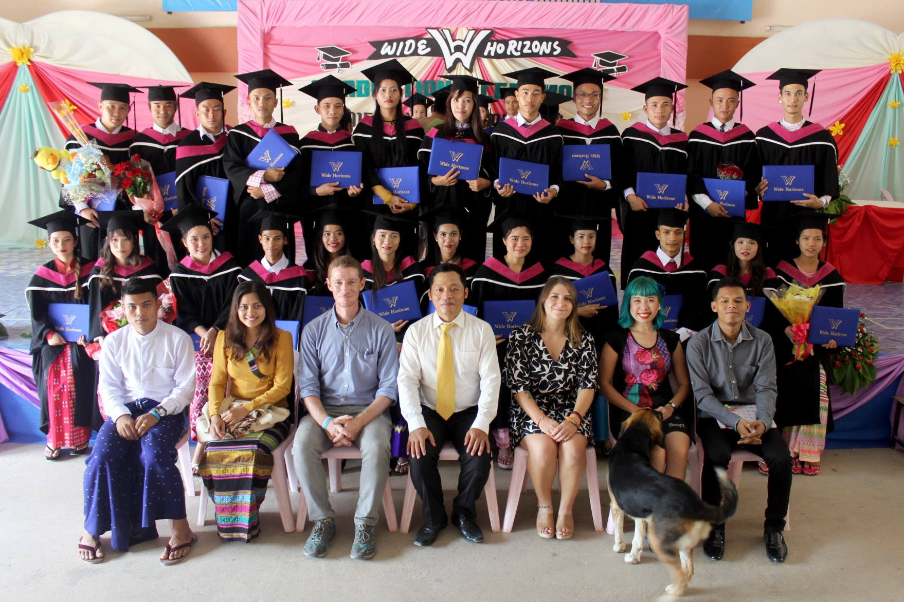 Jordan Pescrillo '12 (seated third from right) with the graduating class at the Wide Horizons Community Development Center. (Photo courtesy of Jordan Pescrillo)
