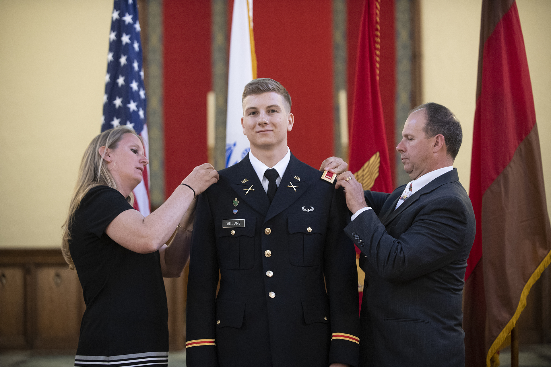 Garnet Williams with his parents at commissioning ceremony in May 2019.