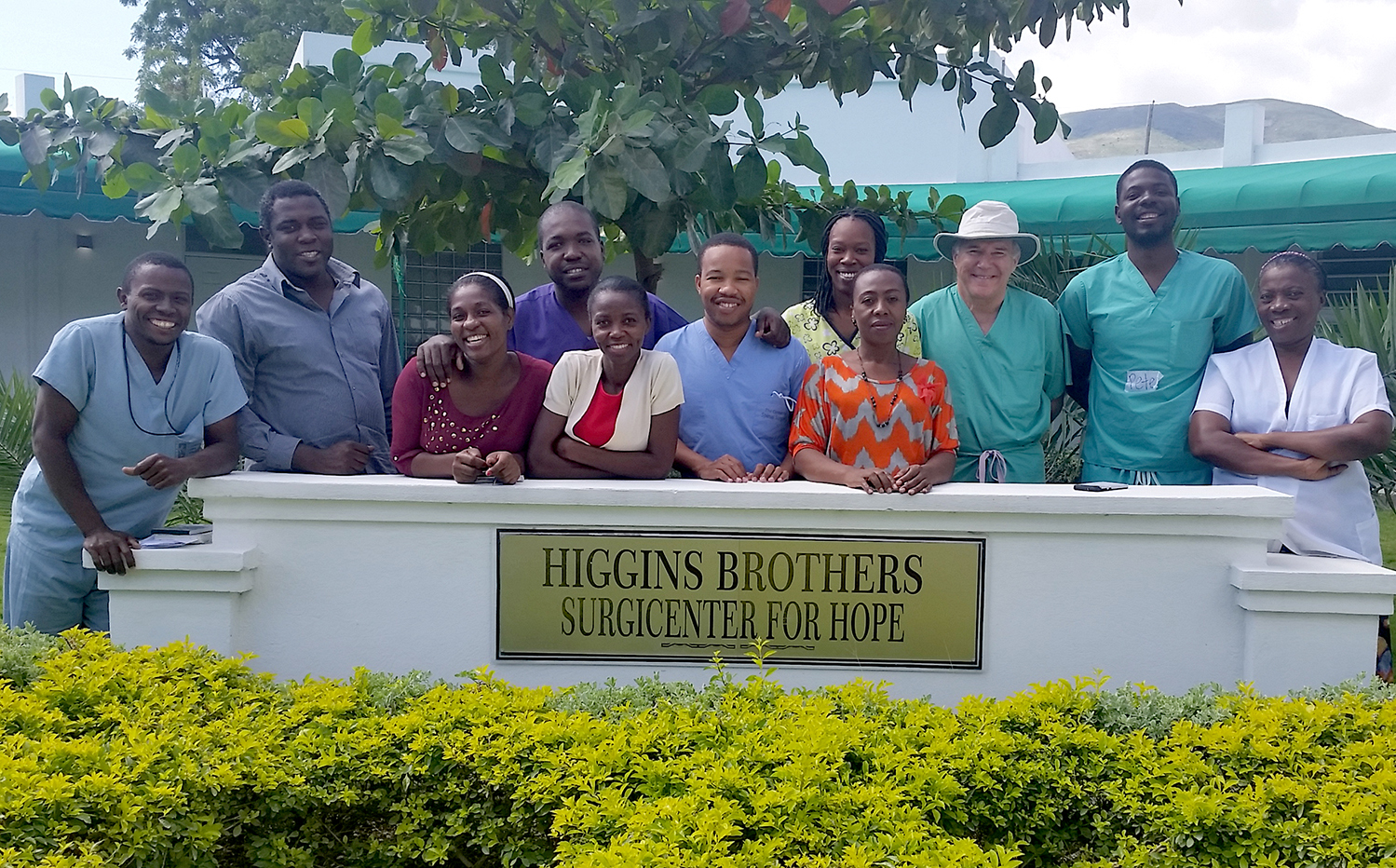 Ted Higgins '71 with the surgical staff of Higgins Brothers Surgicenter for Hope