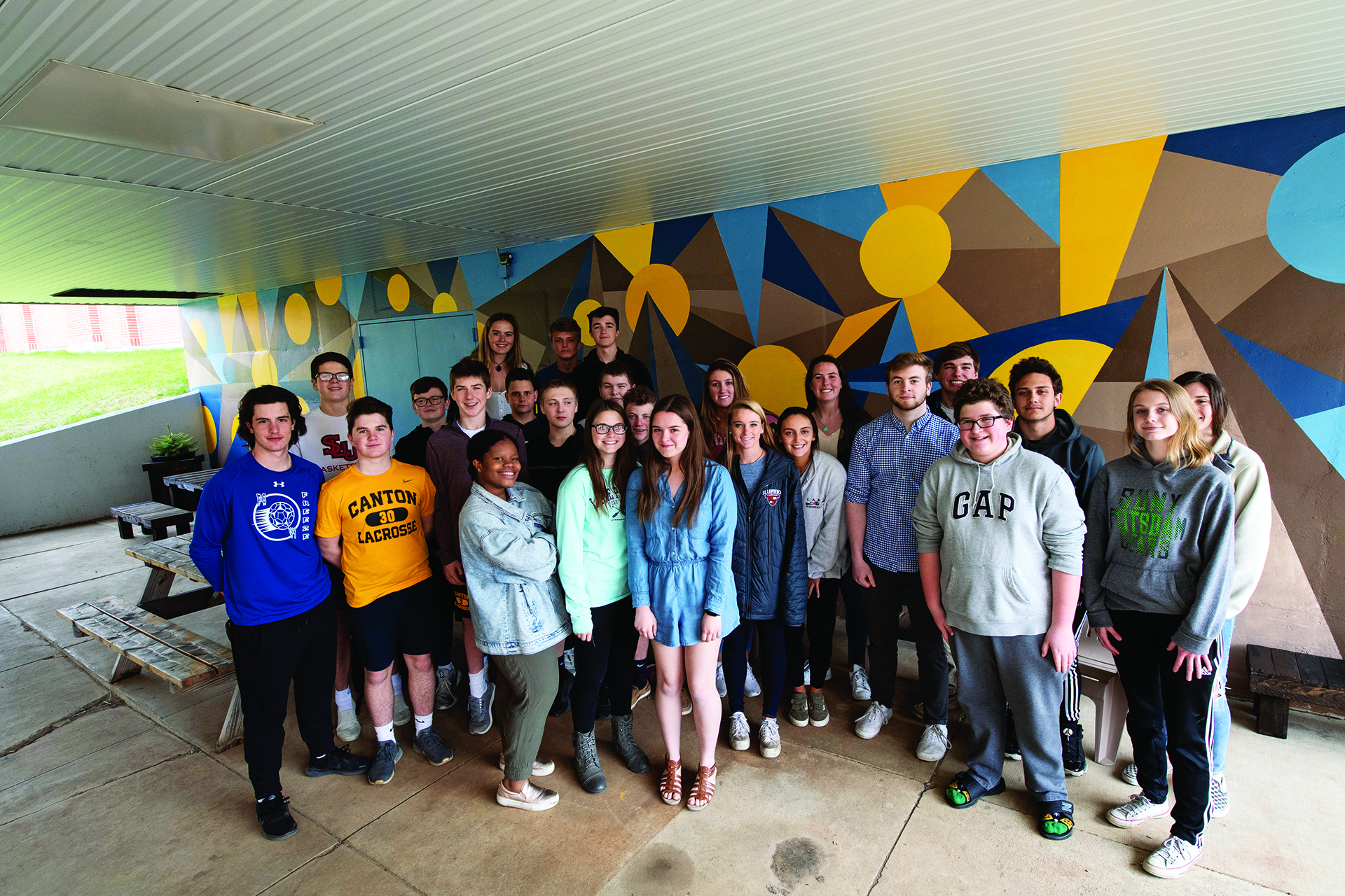 St.Lawrence and Canton Central High School students at the mural site.
