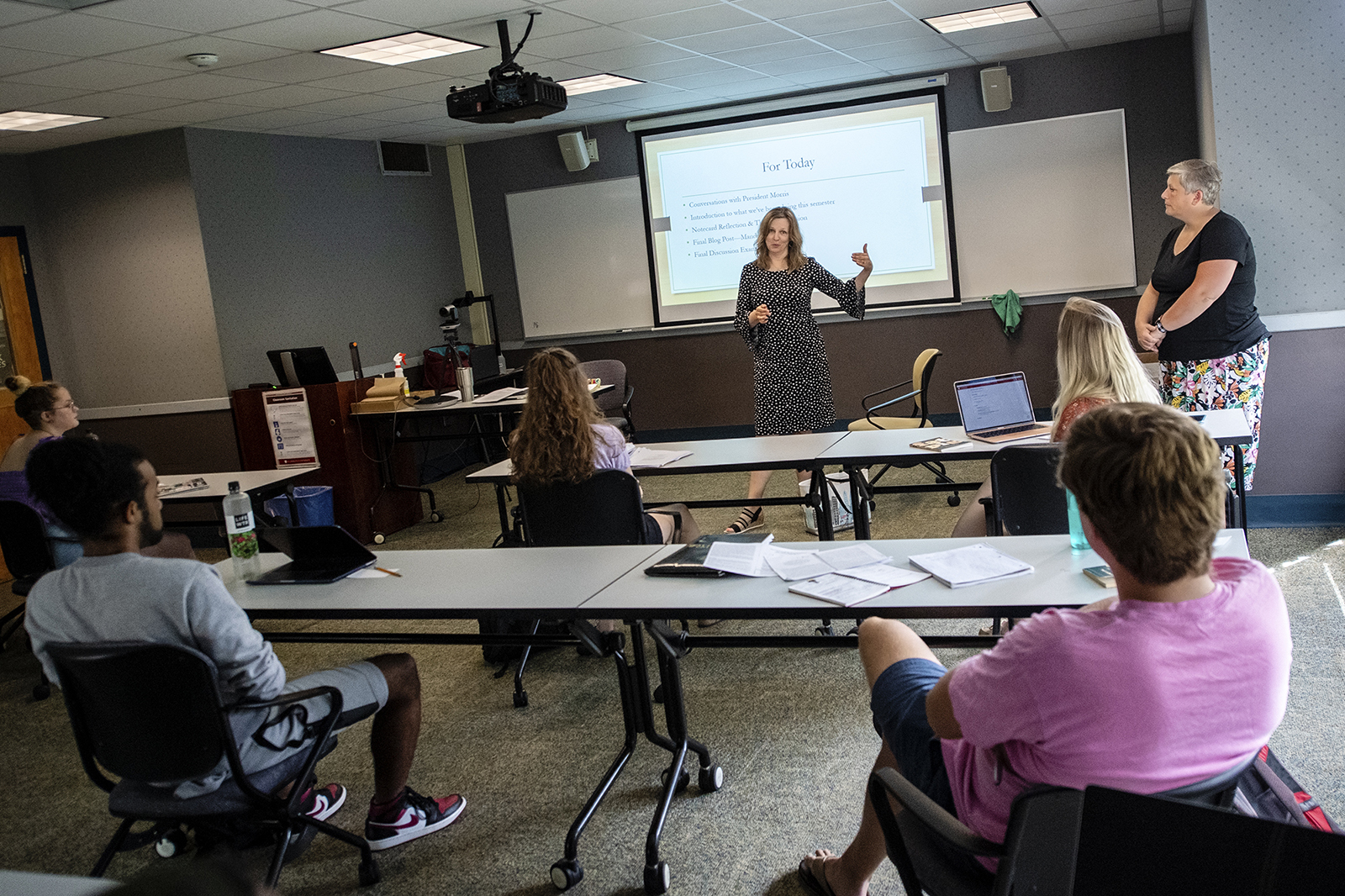 Kate Morris speaks with students in a classroom