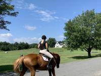 Margola at home riding her horse