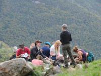 Students taking notes on the mountainside.