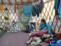 A student and her dog inside one of the yurts