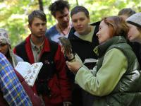Students learning about a bird