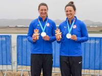 Two team members with their medals
